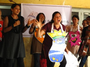 "Lisa playing the ""germ king"" in a production of Hath Mein Sehat's health and hygiene education program at a primary school performance in Hubli, Karnataka."